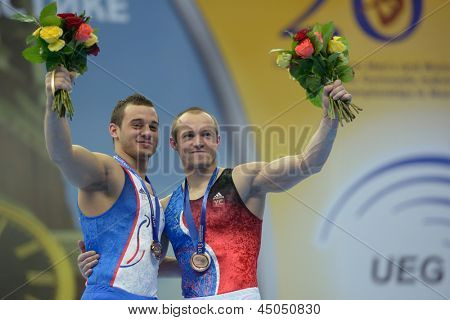 MOSCOW, RUSSIA - APRIL 20:  Ait Said, left, and Pinheiro-Rodrigues, both - France win medals on still rings of 5th European Championships in Artistic Gymnastics in Moscow, Russia on April 20, 2013