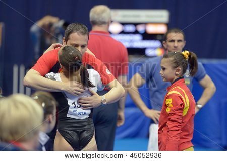 MOSCOW, RUSSIA - APRIL 21: Iordache, Romania accept congratulations after exercise on balance beam in final of 5th European Championships in Artistic Gymnastics in Moscow, Russia on April 21, 2013