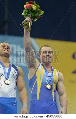 MOSCOW, RUSSIA - APRIL 20: Radivilov, Ukraine, right, and Ait Said, France win gold medals on still rings on 5th European Championships in Artistic Gymnastics in Moscow, Russia on April 20, 2013