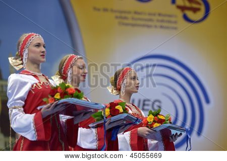 MOSCOW, RUSSIA - APRIL 21: Girls hold awards for winners in parallel bars competitions during 5th European Championships in Artistic Gymnastics in Moscow, Russia on April 21, 2013