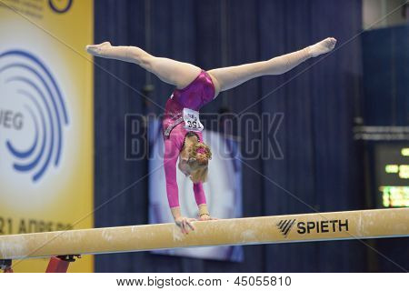 MOSCOW, RUSSIA - APRIL 21: Anastasia Grishina, Russia performs exercise on balance beam in final of 5th European Championships in Artistic Gymnastics in Moscow, Russia on April 21, 2013