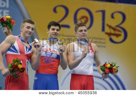 MOSCOW, RUSSIA - APRIL 21: Oldham, Great Britain, left, Garibov, Russia, and Tsarevich, Belarus, right win medals on European Championships in Artistic Gymnastics in Moscow, Russia on April 21, 2013