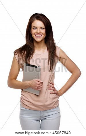 Brunette Woman Carrying A Computer Tablet