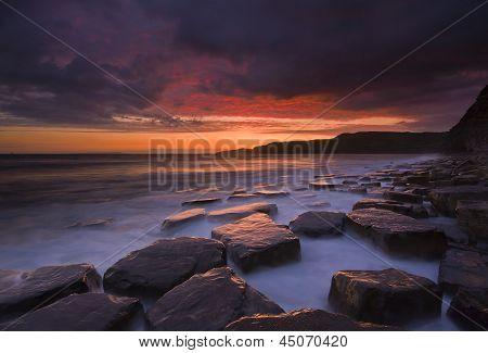 Sunset, sea, rocks and coast at Kimmeridge, Dorset
