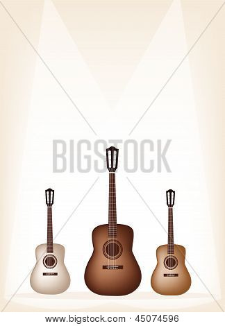 Three Beautiful Guitar On Brown Stage Background