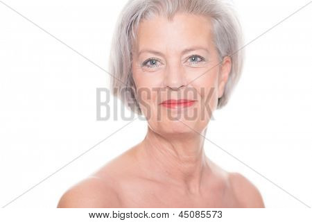 Portrait from a senior woman in front of white background