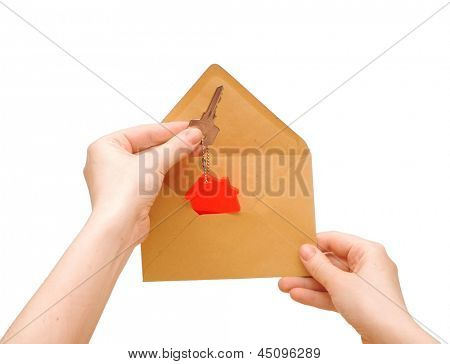a woman's hand gets out of an envelope key with house symbol