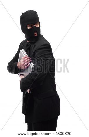 Thief Looking Over Shoulder