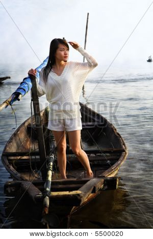 Lady Looking At Sunrise On Traditional Boat