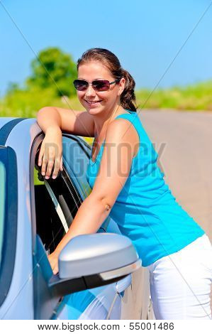 Happy Girl Standing Near Her Car On The Road