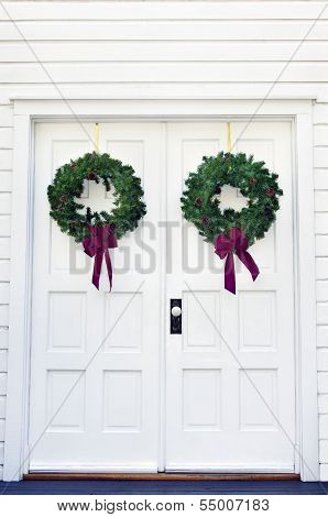 Two Wreaths On A Door