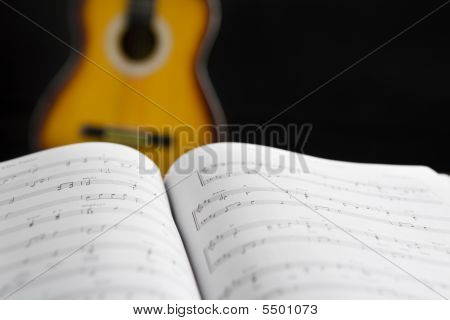 Musical Chords And Guitar On Background