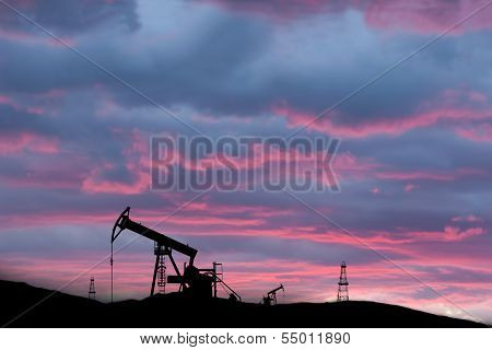 Exploited Oil Field On Sunset