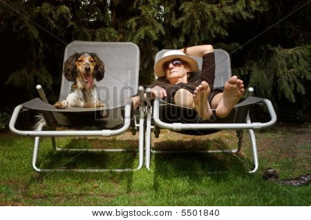 Funny Lady Sunbathing Together With Her Dog