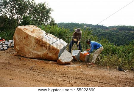 Workers Split Large Rock  For Road-works