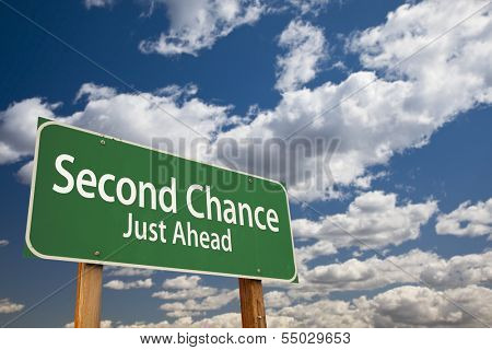 Second Chance Just Ahead Green Road Sign Over Dramatic Clouds and Sky.