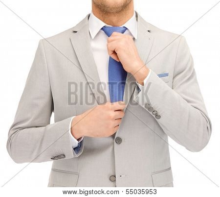 business people and office concept - close up of buisnessman in suit and tie
