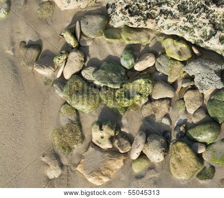 Collection Of Green Pebbles In Sand