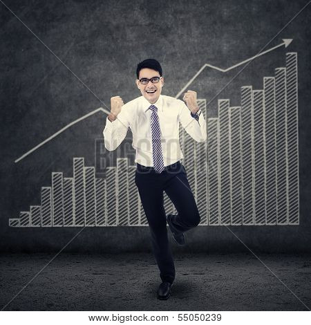 Successfull Businessman And Financial Graph