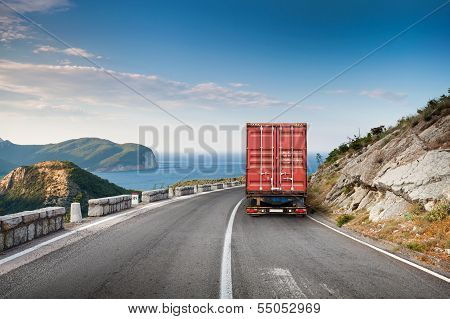 Cargo Truck On The Mountain Highway With Blue Sky And Sea