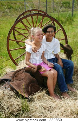 Boy And Girl On Hay
