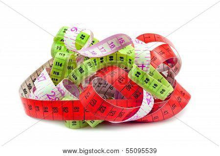 Various entangled measuring tape .