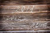 Year 2014  are coming - written on wooden background poster