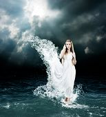 Woman in Splashing Dress Walking on Stormy Sea. Aphrodite Godess Collage. poster