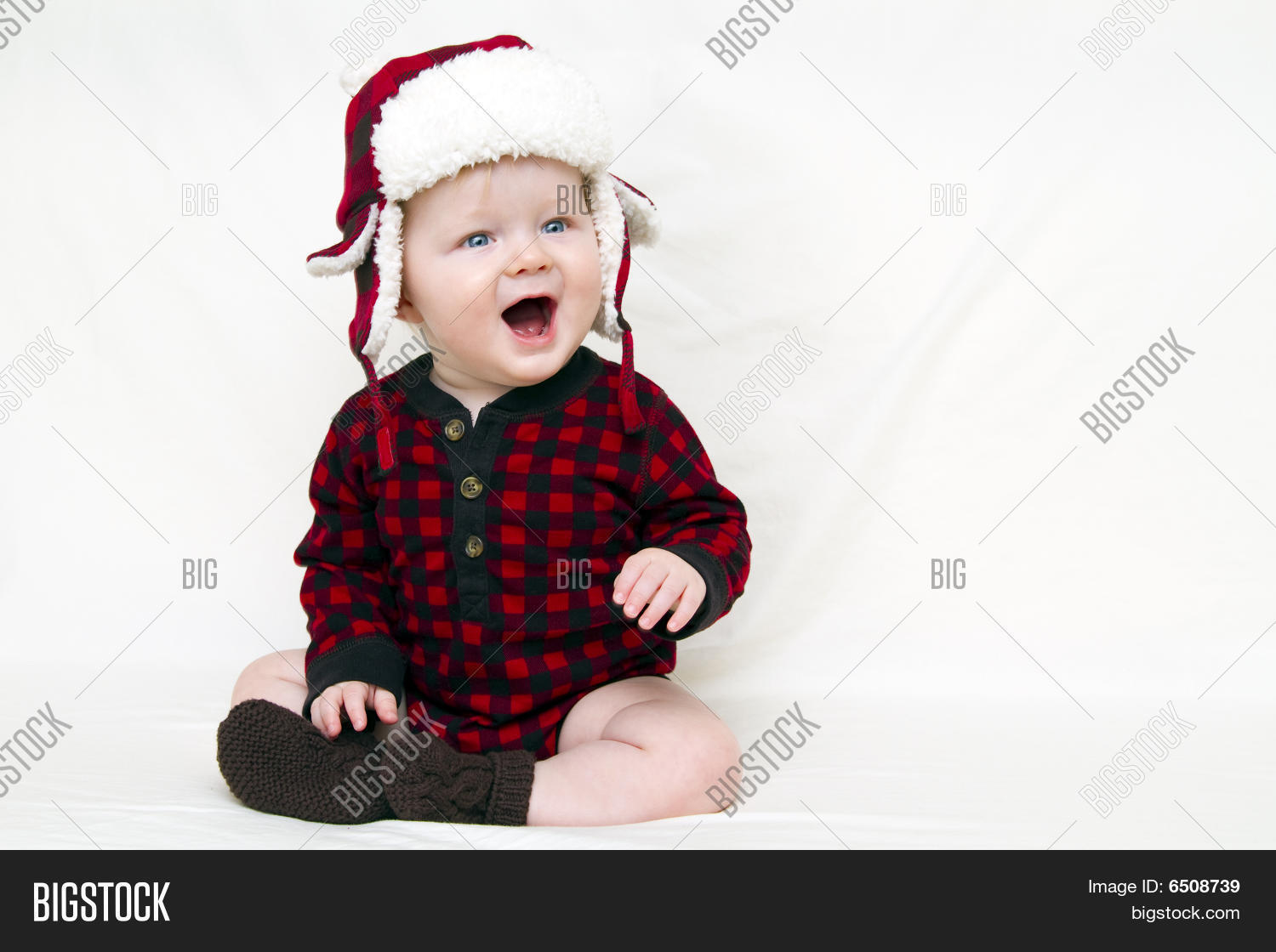 b78e78f43 Christmas Baby With Red Plaid Shirt And Furry Wool Hat, Mouth Open