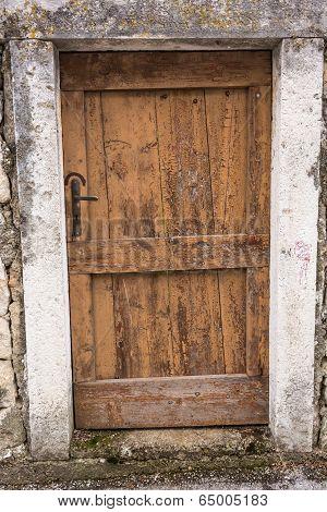 Old Wooden Door In A Wall