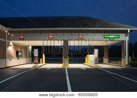 JACKSONVILLE, FL - MAY 13, 2014: A Regions Bank Drive Thru at night in Jacksonville. Regions Bank operates 1,700 branches and 2,400 ATMs across 16 southern states in the U.S.