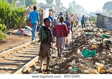 NAIROBI, KENYA - FEBRUARY 6, 2014: Children living in the slums of Kibera on February 6, 2014 in Nairobi, Kenya. The largest slum of Africa is in Nairobi. About 270 thousand people living in Kibera.