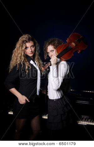 Two Beautiful Young Women With Violon And Piano