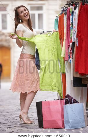 young girl trying on clothes poster