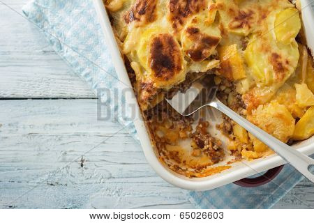 Moussaka, potato-based dish popular in Balkan and Mediterranean cuisines poster