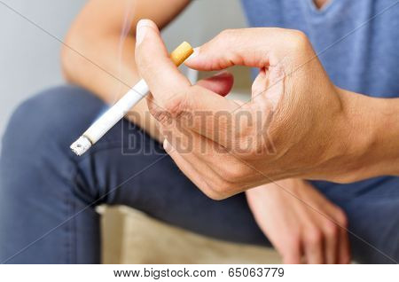 a young man smoking a cigarette