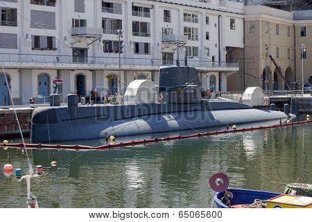GENOA, ITALY - JUNE 16, 2012: Italian Navy Nazario Sauro class submarine converted to museum (Galata Sea Museum) in Genoa old port.