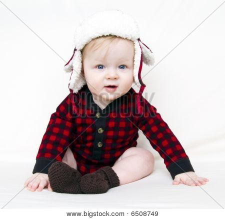 Christmas Baby With Red Plaid Shirt And Furry Wool Hat