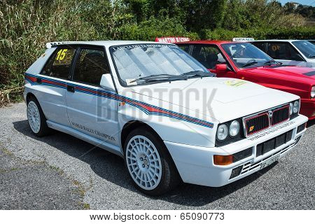 White Lancia Delta Rally Car