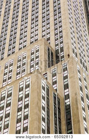 Facade Of Skyscraper With Statue Of Man