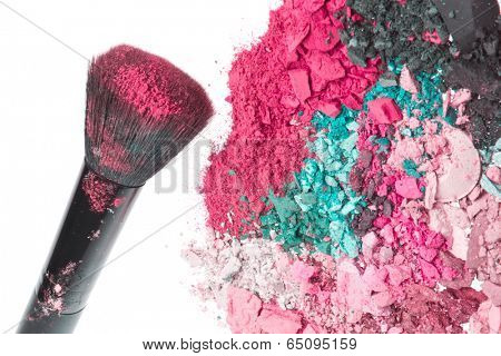 crushed eyeshadows with brush isolated on white background