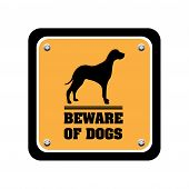 Yellow warning plate with dog silhouette and the text beware of dogs written below the dog shape poster