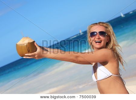 Pretty Woman Holding Coconut By  Hands