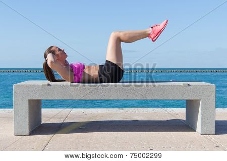 Hispanic Woman Doing Ab Crunches For Fitness