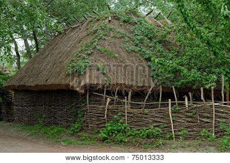 Farmer's barn under the thatch roof in open air museum Kiev Ukraine