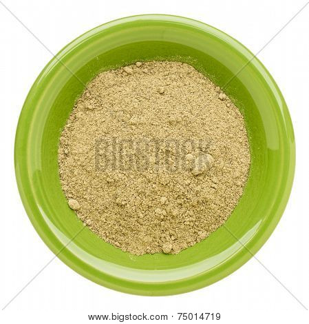 hemp protein powder  on an isolated green bowl