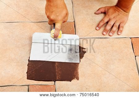 Phases Of Laying Ceramic Floor Tiles - Apply The Joint Material