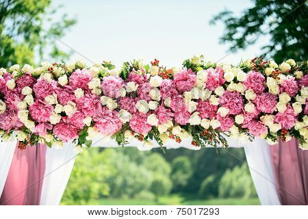 Part of wedding arch with pink and white flowers poster
