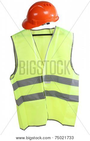 Construction hard hat and high visibility vest on a white background