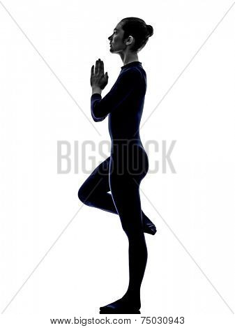 woman exercising Vrksasana tree pose yoga silhouette shadow white background